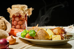 Jacket potatoes and roast chicken Stock Photos