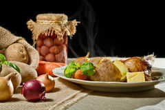 Jacket potatoes, vegetables and roast chicken Royalty Free Stock Photography