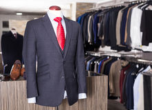 Jacket with shirt and tie on mannequin Stock Photos