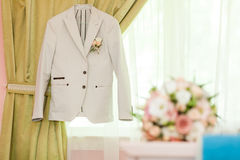 Jacket and wedding bouquet Stock Photography