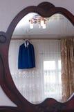 Jacket. Wedding jacket hanging over the window ledge royalty free stock photo