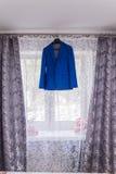 Jacket. Wedding jacket hanging over the window ledge royalty free stock photography