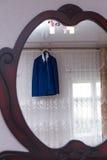 Jacket. Wedding jacket hanging over the window ledge royalty free stock photos