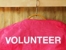 A jacket with a word volunteer on it royalty free stock photography