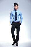 Jacketless business man stands with hands in pockets Royalty Free Stock Images