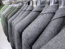Jackets. A row of elegant jackets hanged and displayed in a clothes shop Stock Image