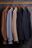 Jackets on hangers Royalty Free Stock Photos