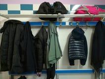 Jackets hanging. On a coat rack Stock Photos