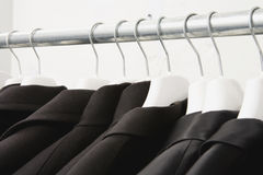 Jackets hanging on rail close-up Stock Photography