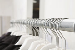 Jackets hanging on rail close-up Stock Photo