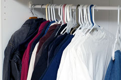 Jackets and shirts inside closet Royalty Free Stock Photo