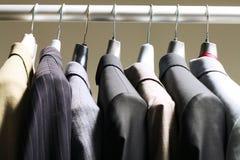 Jackets in wardrobe Stock Photos