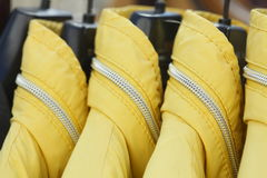 Jackets. Yellow Jackets on a clothes rail Stock Photography