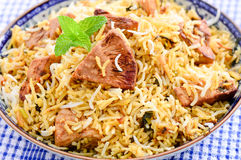 Jackfruit Biryani. Biryani, biriani, or beriani is a set of rice-based foods made with spices, rice usually basmati and meat, fish, eggs or vegetables like Royalty Free Stock Photography
