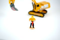 Jackhammer. Toy Construction Worker isolated on a white background Royalty Free Stock Photography