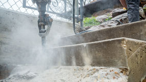 Jackhammer in action. Jackhammer working on the construction site Royalty Free Stock Image