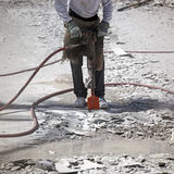 Jackhammer. Breaking up swimming pool for resurfacing Royalty Free Stock Photography