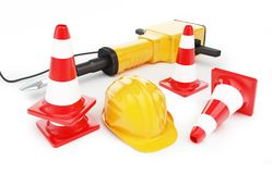 Jackhammer construction helmet traffic cones. Road cone Stock Photo