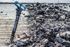 Jackhammer in the middle of the road. A jackhammer in the middle of the road Royalty Free Stock Photo
