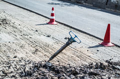 Jackhammer in the middle of the road. A jackhammer in the middle of the road Royalty Free Stock Image