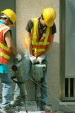 Jackhammers2. Construction workers operating jackhammers breaking up concrete Royalty Free Stock Images