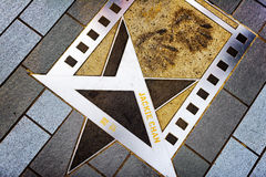 Jackie Chan's name and hand prints on the metal star on the Aven. Ue of Stars on the waterfront in Hong Kong. Hong Kong is popular tourist destination of Asia royalty free stock photography