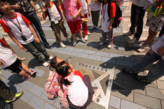 Jackie Chan Star. Children around the Star of Jackie Chan in the Avenue of Stars of Hong Kong, China stock photos
