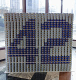 Jackie Robinson-voedselbeeldhouwwerk in CaDelectable me wordt voedselbeeldhouwwerk bij Canstruction-de concurrentie in New York wo Stock Foto