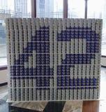 Jackie Robinson-voedselbeeldhouwwerk in CaDelectable me wordt voedselbeeldhouwwerk bij Canstruction-de concurrentie in New York wo Stock Foto