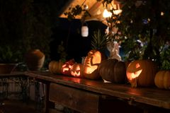 Jackolantern pumpkins at night. Jack o lantern pumpkins lit up at night in a garden setting for Halloween royalty free stock photos