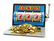 Jackpot, gambling gain, luck and success concept, casino app. Laptop computer with slot machine with winning event and heap of gold coins on keyboard on white royalty free stock photography