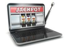 Jackpot.  Laptopspielautomat. Stockfoto