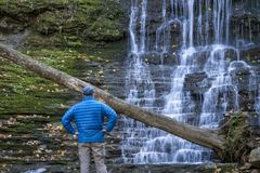 Jackson Falls at Natchez Trace Parkway. A male visitor at Jackson Falls at Natchez Trace Parkway, fall scenery royalty free stock photo