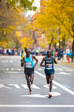 Jackson Kiprop (Uganda) and Stephen Kiprotich (Uganda) run the 2013 NYC Marathon Stock Photos