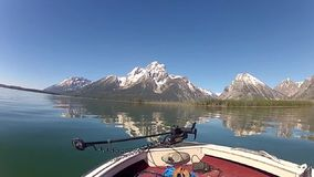Jackson Lake and Tetons in Wyoming. The Jackson Lake and the Tetons mountain in Wyoming seen from a boat in the late spring or early summer stock footage