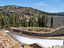 Jackson Meadows Reservoir dam spillway. Water runs down the spillway at Jackson Meadows Reservoir Royalty Free Stock Photo