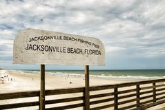 Jacksonville Beach Florida Fishing Pier Sign. Jacksonville Beach, FL USA – August 16, 2015: Landmark pier is almost a quarter of a mile long and gives stock image