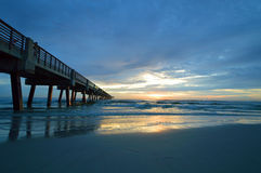 The Jacksonville Beach Pier at Sunrise Stock Images