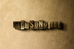 JACKSONVILLE - close-up of grungy vintage typeset word on metal backdrop Stock Photos