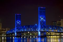 Jacksonville, Florida blue bridge. Bridge in Jacksonville, Florida, light up with blue lights at night royalty free stock photo