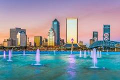 Jacksonville, Florida, USA Skyline. Jacksonville, Florida, USA downtown skyline and fountain at dusk royalty free stock photos