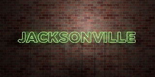 JACKSONVILLE - fluorescent Neon tube Sign on brickwork - Front view - 3D rendered royalty free stock picture Royalty Free Stock Photography