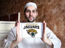 Jacksonville Jaguars american football team logo. Logo of Jacksonville Jaguars american football team on samsung tablet holded by arab muslim man. The royalty free stock photography