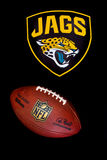 Jacksonville jaguars NFL. ZAGREB , CROATIA - NOVEMBER 20, 2015 :  NFL jacksonville jaguars logo printed on club equipment with official ball , product shot Royalty Free Stock Images