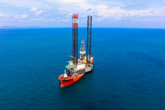 Jackup rig movement. New jackup rig movement and transport by heavy lift vessel for installation at oversea royalty free stock photography