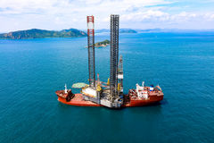 Jackup rig movement. New jackup rig movement and transport by heavy lift vessel for installation at oversea stock images