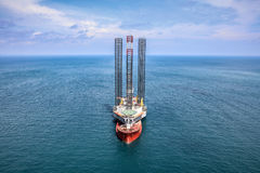 Jackup rig movement. New jackup rig movement and transport by heavy lift vessel for installation at oversea royalty free stock photos
