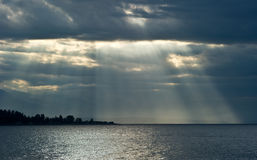 Jacob's Ladder/ Stairway To Heaven. Sun beams break through storm clouds Stock Photo