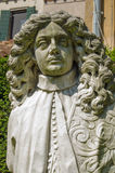 Jacobean Statue, Venice. Historic statue of a man in full bottomed wig dating from the seventeenth century.  On public display in the gardens beside Ca'Rezzonico Royalty Free Stock Photography
