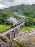 The Jacobite crossing the Loch nan Uamh Viaduct Stock Images
